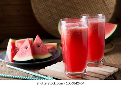 Watermelon smoothie on wood background , healthy drink