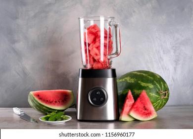 Watermelon smoothie on wood background , healthy drink. Summer. Watermelon pieces. Blender