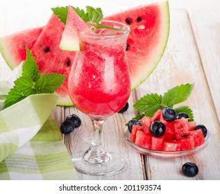 Watermelon smoothie on a wooden table. Selective focus