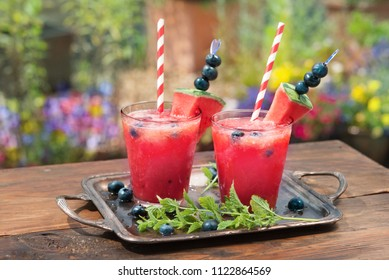 Watermelon summer drink with blueberry in a glass, on the terrase