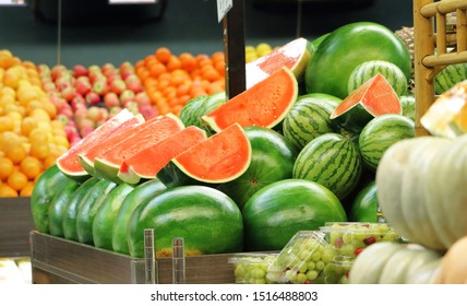 Watermelons stacked up in a fruit and vegetable shop.