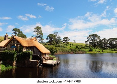 A watermill by the lake with background of beautiful blue sky Hobbiton (Movie Set), New Zealand