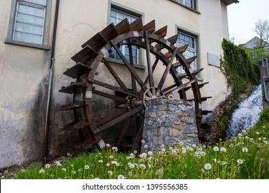 Watermill at the Rhine Falls in Switzerland. Spring nature. Wassermühle in der Schweiz.