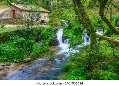 Watermill and waterfall in Armenteira river on the forest of stone and water route in Meis town, Galicia, Spain