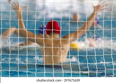 Waterpolo Action/A water polo goalkeeper arises challenging for the ball. blur