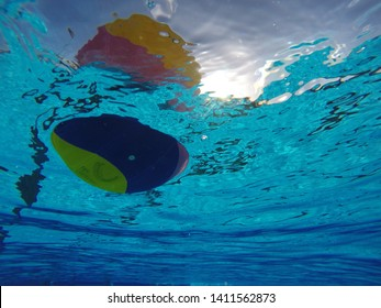 Waterpolo ball view from underwater with sun behind