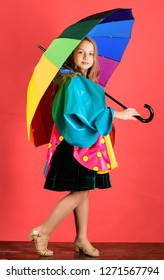 Waterproof accessories manufacture. Waterproof accessories make rainy day cheerful and pleasant. Kid girl happy hold colorful umbrella wear waterproof cloak. Enjoy rainy weather with proper garments.