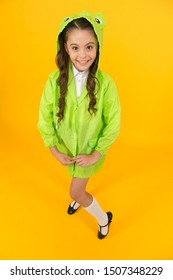 Waterproof accessory. Kid girl happy wear raincoat. Cute raincoat kids would love. Frog style. Schoolgirl hooded raincoat enjoy fall weather. Rainproof accessories make rainy fall day pleasant.