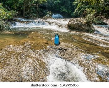 waterproof bag on water stream