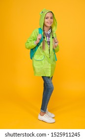 Waterproof cloak. Waterproof fabric for your comfort. Rainproof accessory. Schoolgirl hooded raincoat enjoy rainy weather. Waterproof clothes every kid should try. Kid girl happy wear raincoat.