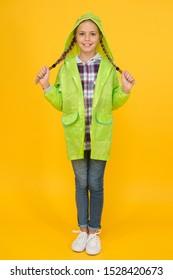 Waterproof cloak. Waterproof fabric for your comfort. Schoolgirl hooded raincoat enjoy rainy weather. Rainproof accessory. Waterproof clothes every kid should try. Kid girl happy wear raincoat.