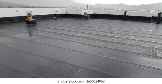 waterproof laying roll roof construction site