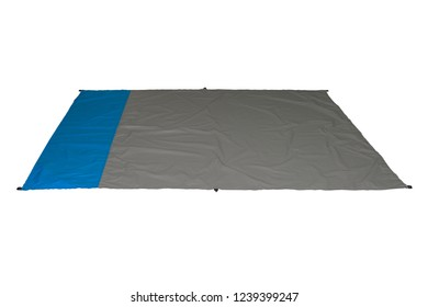 Waterproof and sandproof nylon beach blanket isolated on white background. Very thin tarp or footprint used for outdoor activities. Clipping path included.