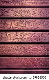 Waterproof wood brown vintage background with water drops