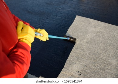 Waterproofing coating  with a roller brush.