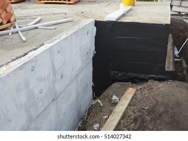 Waterproofing foundation bitumen and insulation with polystyrene foam boards for House Energy Saving. Damp proofing Coatings.Waterproofing house foundation with spray on tar.