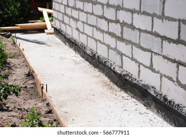Waterproofing and insulation house  foundation wall. Foundation Waterproofing and Damp proofing Coatings. Waterproofing house foundation with bitumen membrane.