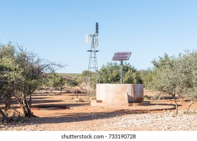 A water-pumping windmill and solar panels for a waterpump near Schmidtsfrift, a village in the Northern Cape Province of South Africa