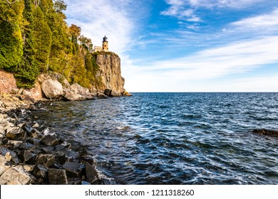 The Waters of Lake Superior Lap Up on to a Boulder Strewn Beach Below Split Rock Lighthouse in Northeastern Minnesota
