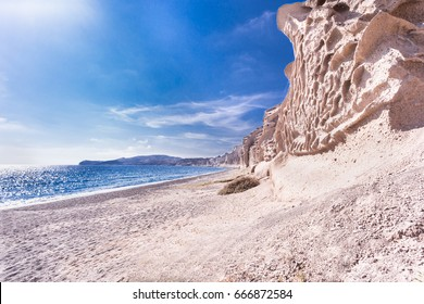 Waters of mediterranean sea and cliffs. Santorini, Greece.