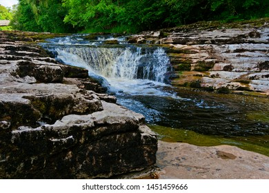 The waters of the River Ribble become blurred as they pass over Stainforth Force in the Yorkshire Dales