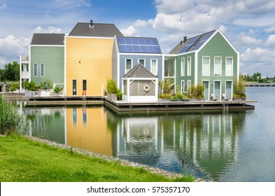 Waterside Colourful Ecological Wooden Houses with Solar Panels on the Roof