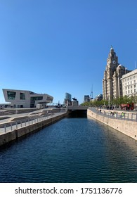 Waterside in Liverpool. Pier Head Waterfront. Mersey River. St John's Tower Cathedral. Three Graces. Before COVID-19 pandemic lockdown. Liverpool / England - July 1, 2019