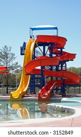 Waterslide in a city park, early spring in bright sunlight. Anticipation of summer.