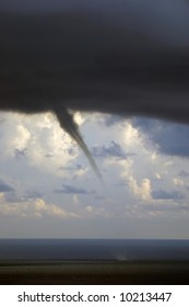 A waterspout forms during an afternoon thunderstorm on St Thomas, US Virgin Islands. Common during hurricane season.