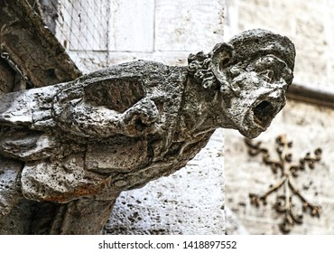 A waterspout gargoyle  on the building facade of the neo-Gothic courtyard of the city hall of Munich, Germany