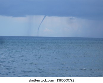 A waterspout from a storm over the sea southeast of Dumaguete City, Negros Oriental, Philippines