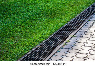 Aqueduct Between Nature And City. Iron Grate Of Water
