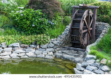 Delicieux Waterwheel In Garden