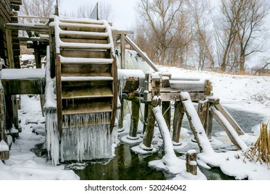 Waterwheel of old watermill covered with Icicles