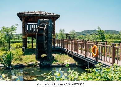 Waterwheel and pavilion at Wangsong Lake park in Uiwang, Korea