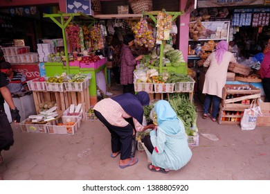 Wates,Kulon Progo - May 05 2019: women are choosing vegetables to buy at local market,located in pasar wates (wates traditional market)