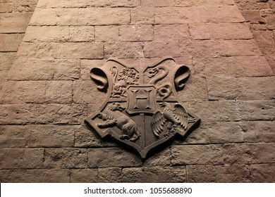 Watford / England - 03/12/2015: Coat of arms of Hogwarts present on a wall in the common hall of the castle of Harry Potter