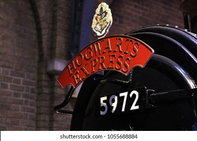 Watford / England - 03/12/2015: Detail of the Hogwarts express locomotive with the red writing and the number of the train departing from platform nine and three quarters
