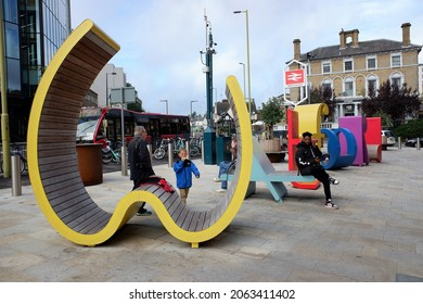 Watford, Hertfordshire, England, UK - October 25th 2021: Art installation of giant coloured letters spelling Watford on the forecourt of Watford Junction Station
