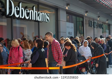 Watford, Hertfordshire / UK - September 27 2018: Crowds gather for the opening of the new style Debenhams store in Watford. Also the first store in the new Intu Shopping Centre extension.