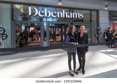 Watford, Hertfordshire / UK - September 27 2018: Ribbon cut by Megan Bowyer & Julien Macdonald OBE. At the opening of the new style Debenhams store in Watford.