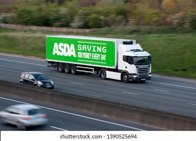 WATFORD, UK - APRIL 19, 2019: Evening traffic on British motorway M1. Walmart Asda lorry in motion .