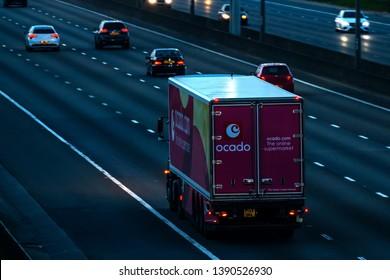 WATFORD, UK - APRIL 19, 2019: Evening traffic on British motorway M1, Ocado lorry on the road.