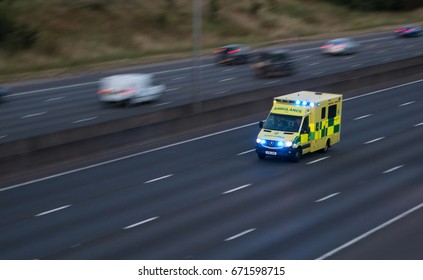 WATFORD, UK - JULY 2, 2017: Ambulance in rush on the British motorway M1