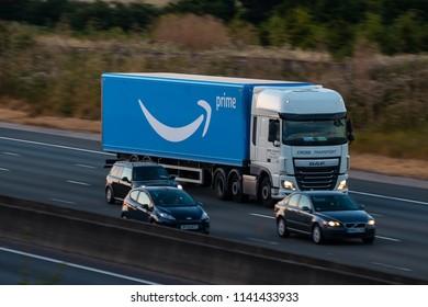 WATFORD, UK - JULY 22, 2018: Lorry belonging to Amazon, in motion on the British motorway M1