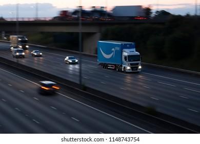 WATFORD, UK - JULY 31, 2018: Amazon Prime lorry in motion on British motorway M1 during sunset
