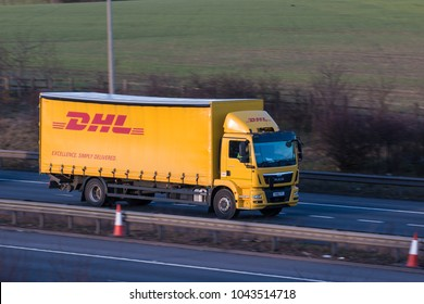 WATFORD, UK - MARCH 8, 2018: Yellow DHL Lorry in motion on the British motorway M1