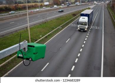WATFORD, UK - NOVEMBER 15, 2018: Green Highway England ANPR camera monitoring traffic flow on British motorway M1