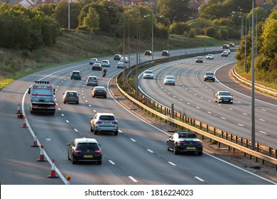 WATFORD, UK - SEPTEMBER 13, 2020: Sunday afternoon traffic on British motorway M1 near town Watford