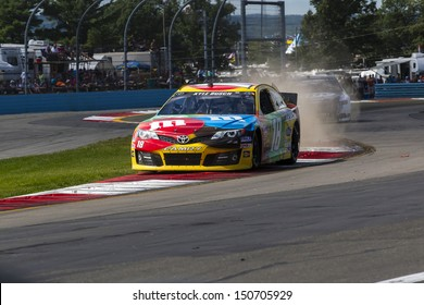 WATKINS GLEN, NY - AUG 11, 2013:  Kyle Busch (18) wins the Cheez-It 355 at The Glen race at the Watkins Glen International in Watkins Glen, NY on Aug 11, 2013.